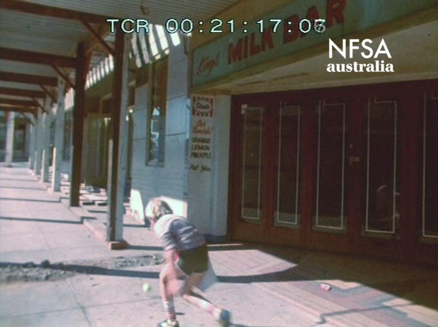 A boy skips past the site of the demolition of the Kings Cinema Ashfield